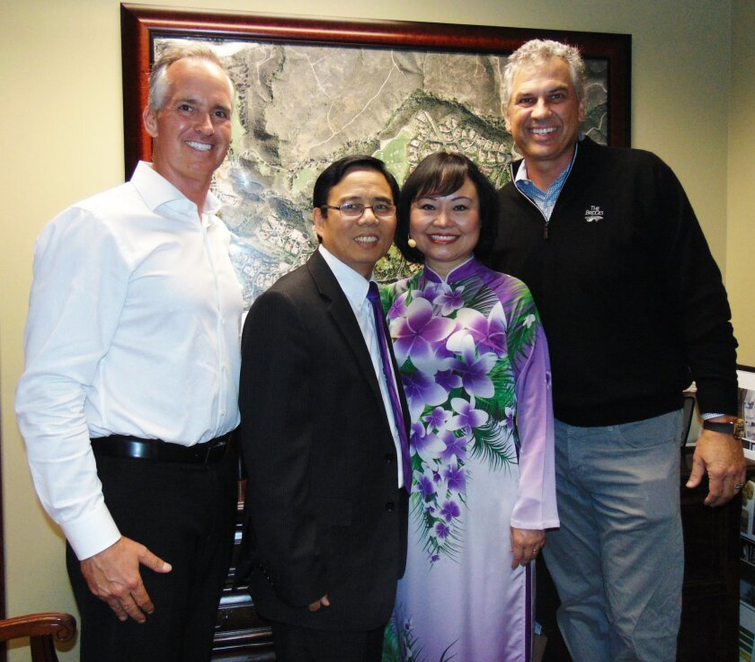 L-R, Ken Ayers, development director at The Bridges of Rancho Santa Fe, Bui Huy Toan, Kim Phuc, JR Meyers. Photo by Diane Y. Welch
