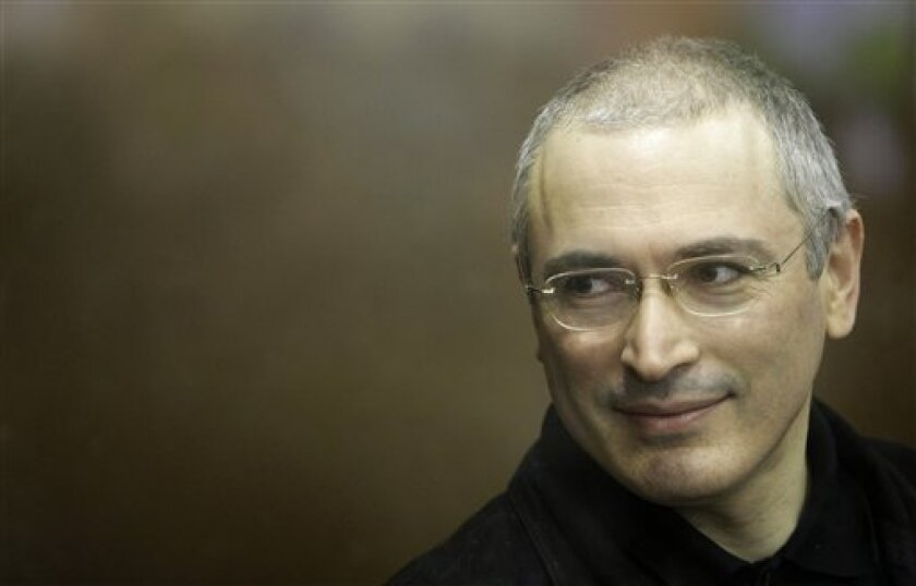 Former Yukos CEO Mikhail Khodorkovsky stands behind a glass pane at a court in Moscow, Russia, Tuesday, Nov. 2, 2010. Jailed oil tycoon Mikhail Khodorkovsky has given an impassioned final address to a Moscow court, telling the judge that the fate of the entire nation rests on the verdict he is expected to deliver Dec. 15. (AP Photo/Misha Japaridze)