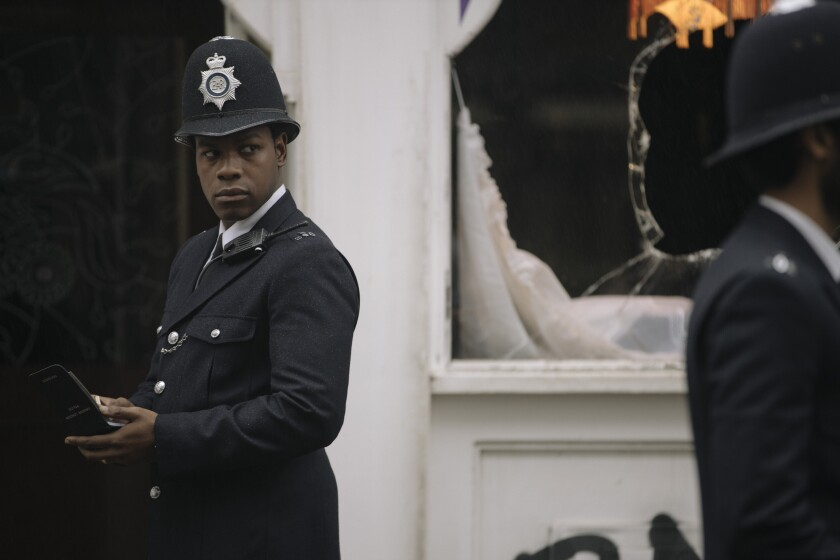 """John Boyega looks to the side in a scene from Steve McQueen's """"Red, White and Blue"""""""