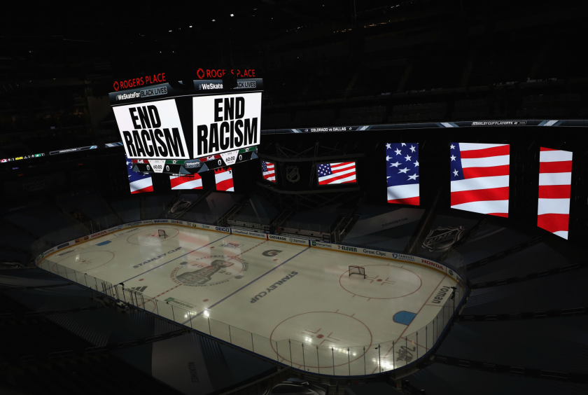 """End Racism"" is displayed on the scoreboard in light."
