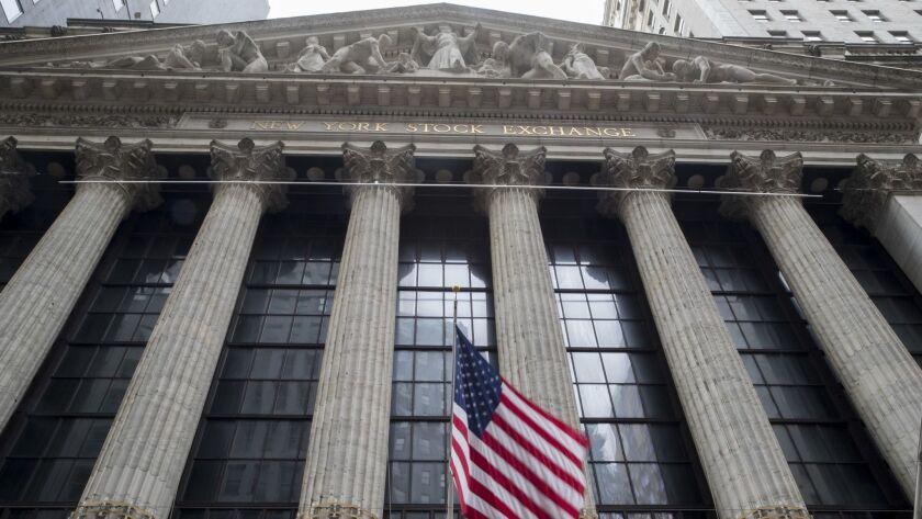 A U.S. flag flies outside New York Stock Exchange.