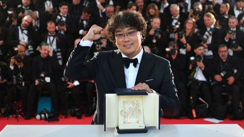 """Bong Joon-ho became the first South Korean director to win the Palme d'Or, receiving Cannes' top prize for """"Parasite."""""""