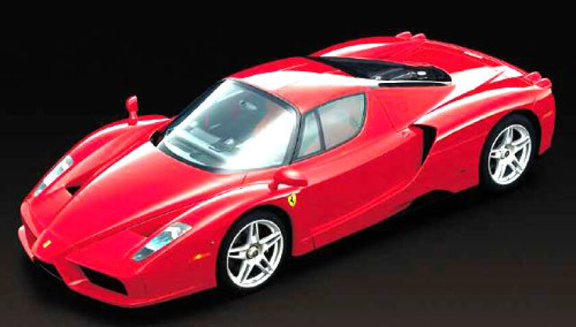 """BEFORE: """"This was not a car. It was a rolling art form,"""" says Tex Otto, who edits magazines for Ferrari owners."""