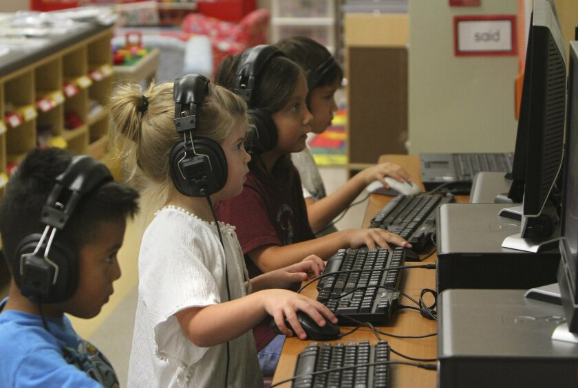 Austin Maldonado, Jamasyn Kelly, Juliana Embry and Cameron Stringer, all students in Alicia Jaime's transitional kindergarten class at Cole Canyon Elementary School in Murrieta, work on computers in their class.