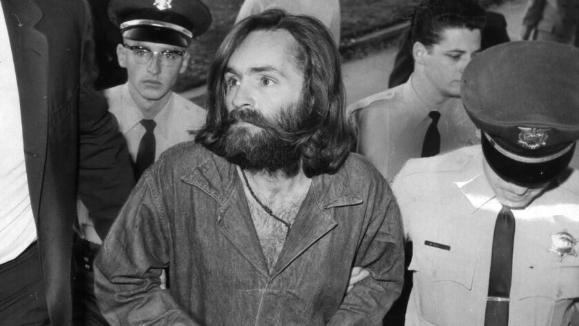 Charles Manson is escorted to court for preliminary hearing on Dec. 3, 1969.