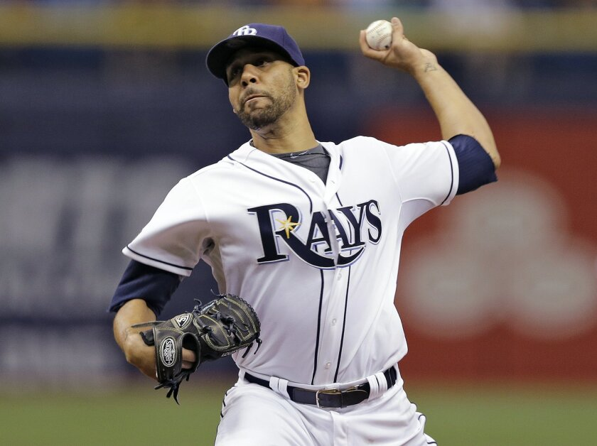 FILE - In this July 25, 2014 file photo, Tampa Bay Rays starting pitcher David Price delivers to the Boston Red Sox during the first inning of a baseball game in St. Petersburg, Fla. The Detroit Tigers added another Cy Young Award winner to their star-studded rotation, acquiring Price from Tampa Ba