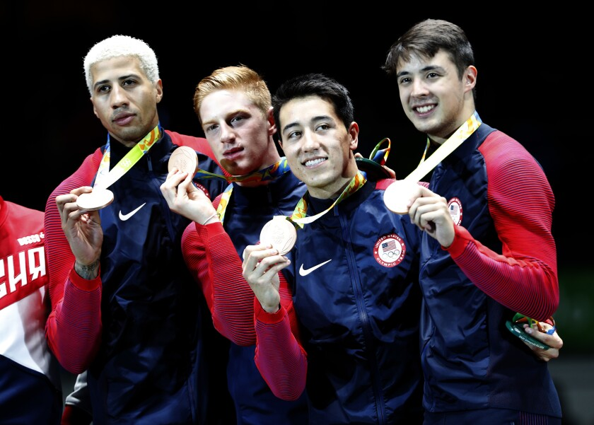 U.S. fencers Miles Chamley-Watson, Race Imboden, Alexander Massialas, and Gerek Meinhardt show off their 2016 Olympic medals