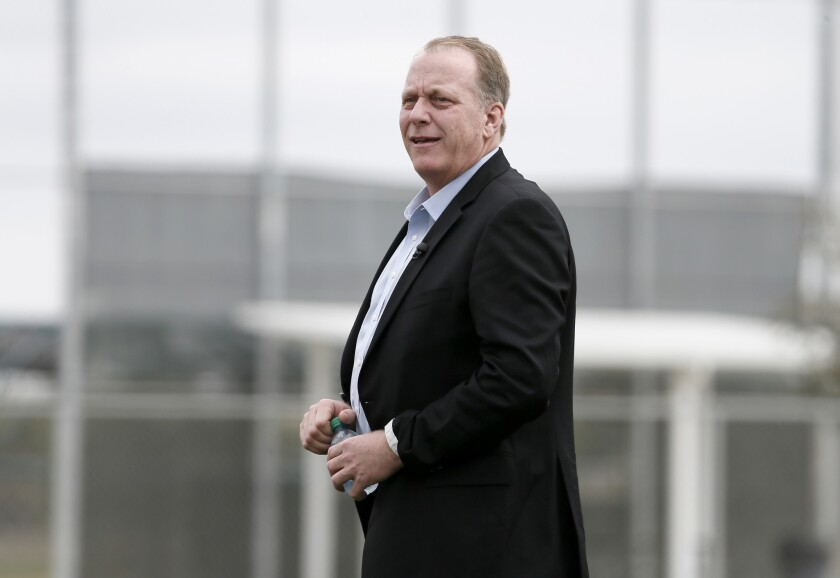 ESPN analyst and former MLB pitcher Curt Schilling watches as the Boston Red Sox work out at baseball spring training in February.