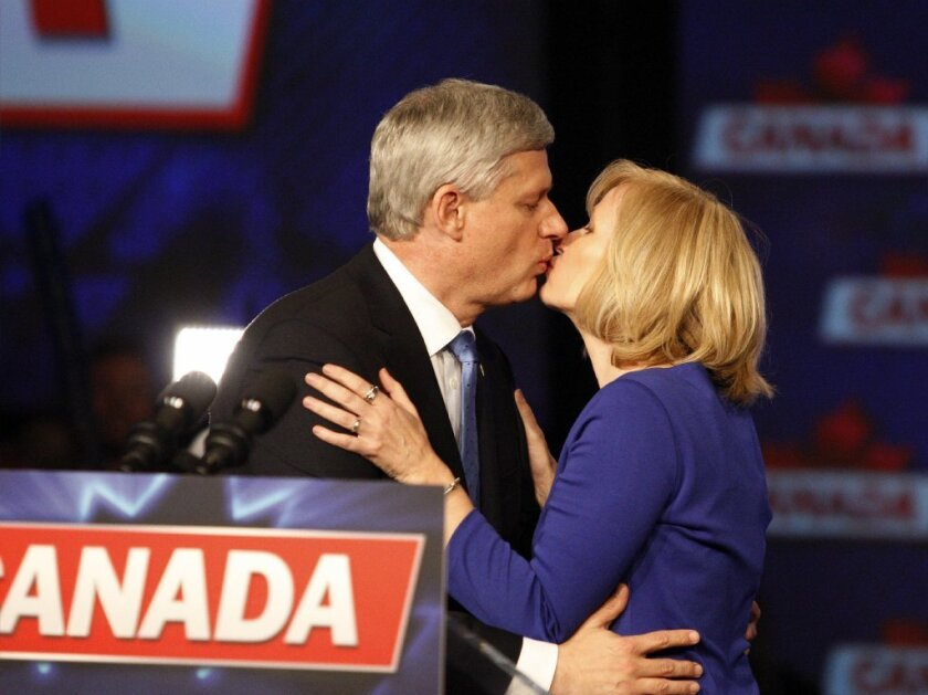 Stephen Harper and his wife, Laureen, smooch before the prime minister addresses supporters on election night. He will be replaced by 43-year-old Justin Trudeau of the Liberal Party.