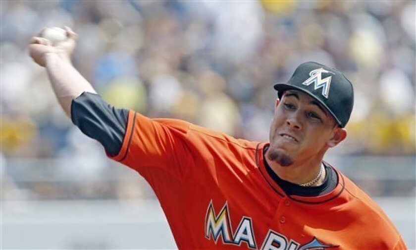 Miami Marlins starting pitcher Jose Fernandez throws against the Pittsburgh Pirates in the first inning of the baseball game on Thursday, Aug. 8, 2013, in Pittsburgh. (AP Photo/Keith Srakocic)