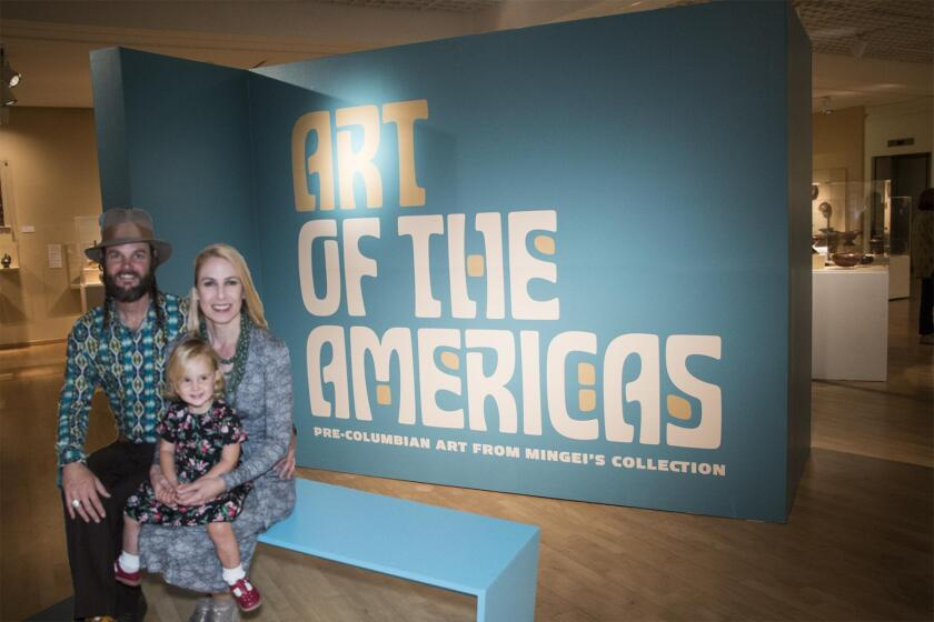 At the Sept. 16, 2017 opening, Mingei International Museum curator Christine Hietbrink poses with her husband Ryan Dean and 2-year-old daughter Hazel.