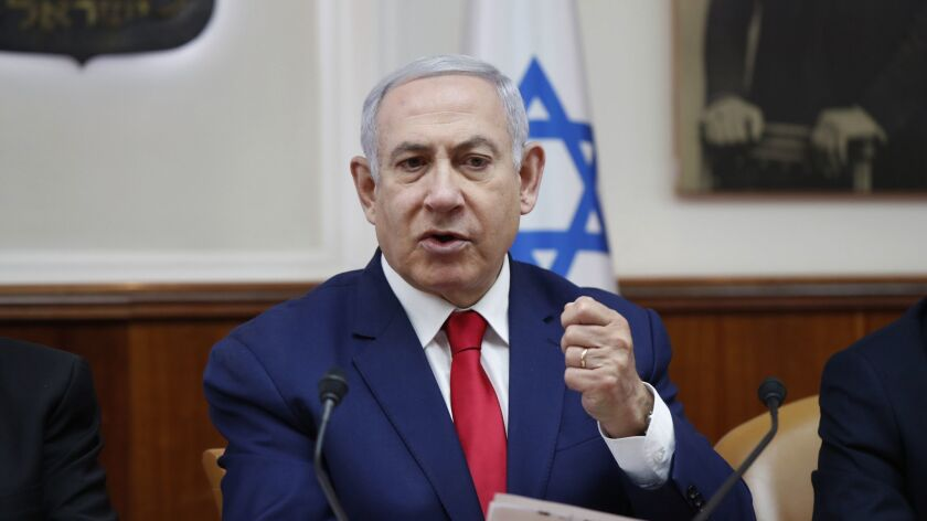 Israeli Prime Minister Benjamin Netanyahu chairs the a weekly cabinet meeting in Jerusalem, Sunday,