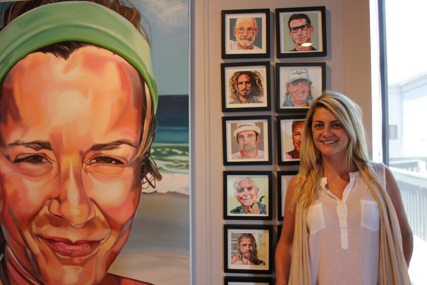 WindanSea photographer Jamie Dickerson (pictured with WindanSea artist Letty Nowak's Faces of Surfing series) has opened J. Dixx Photography studio and art gallery in the second story at 7480 La Jolla Blvd. (at Pearl Street).