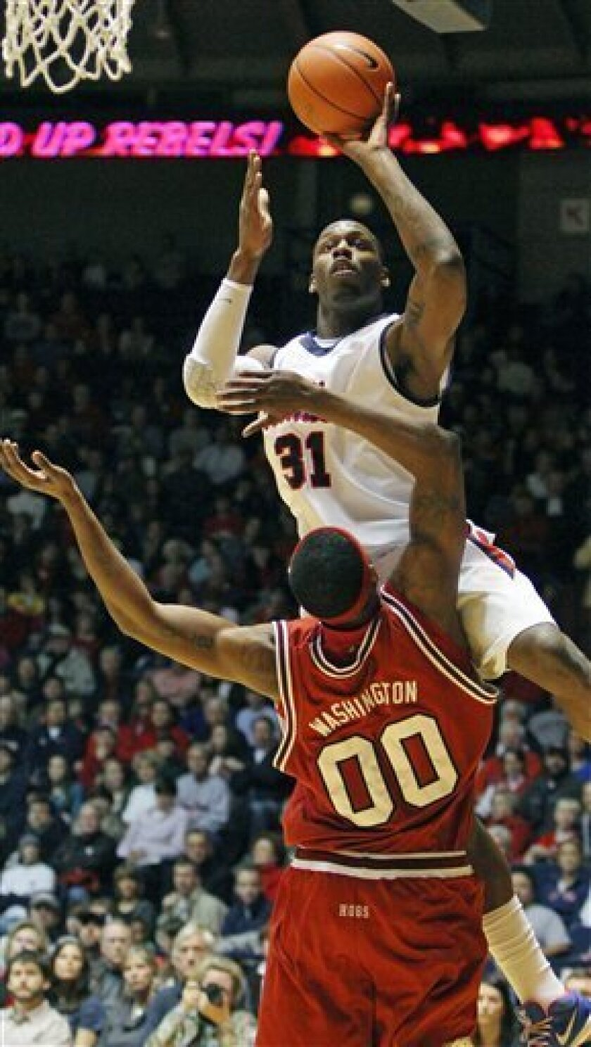 Mississippi forward Holloway Murphy (31) shoots over Arkansas center Mike Washington during the first half of an NCAA college basketball game in Oxford, Miss., Sunday, Jan. 31, 2010. (AP Photo/Rogelio V. Solis)