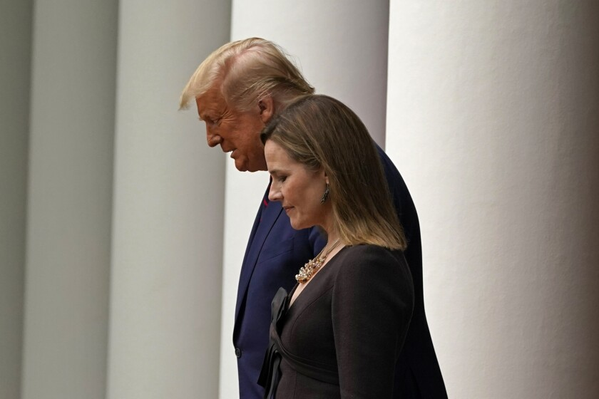 President Trump walks with Judge Amy Coney Barrett to a news conference at the White House on Saturday.