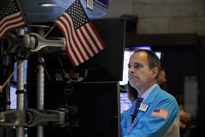 FILE - In this Oct. 2, 2019, file photo specialist John Alatzas works on the floor of the New York Stock Exchange. The U.S. stock market opens at 9:30 a.m. EDT on Tuesday, Oct. 8. (AP Photo/Richard Drew, File)
