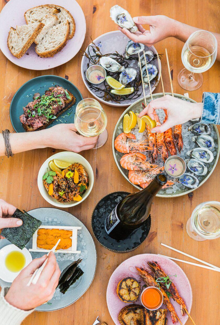 Assorted seafood dishes from the Santa Monica restaurant Crudo e Nudo