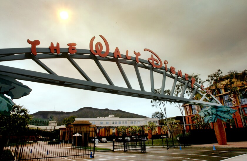 Walt Disney Co. and Dish Network struck a comprehensive distribution deal Monday that brings an end to Disney's lawsuit over Dish's controversial AutoHop ad-skipping feature. Disney corporate headquarters in Burbank, Calif.