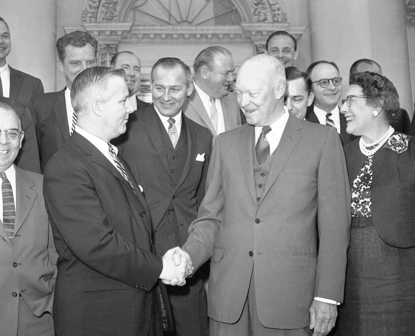 Rep. Arch Alfred Moore Jr. of West Virginia greets President Dwight D. Eisenhower in 1960 after a breakfast at the White House with other Republicans in Congress.