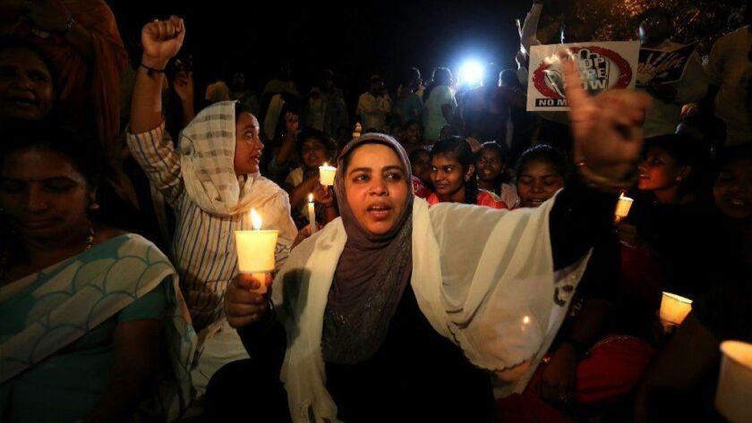 Candle light vigil for Asifa Bano in Bangalore, India - 14 Apr 2018