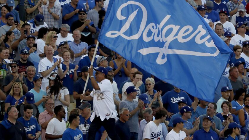 TV personality George Lopez waves a Dodgers flag before Game 1 of the 2017 World Series.