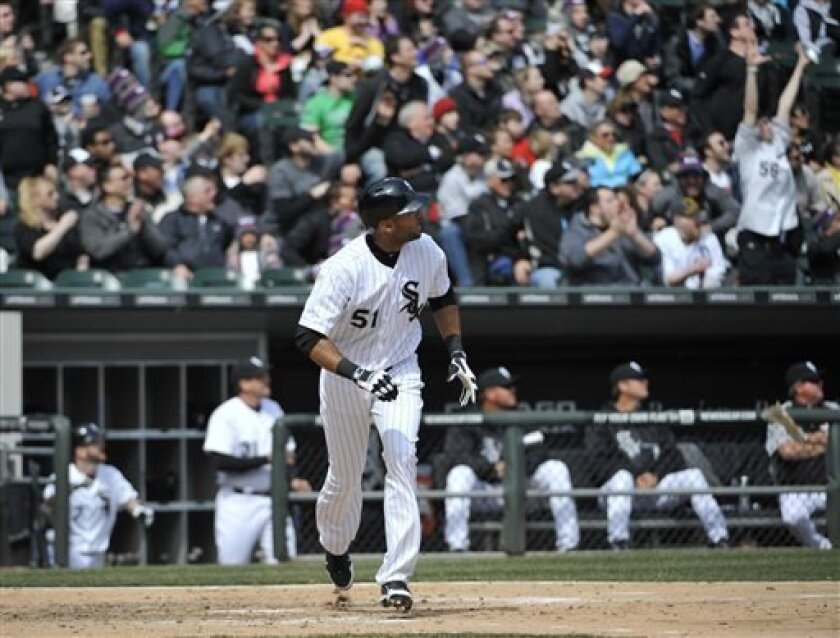 Chicago White Sox's Alex Rios watches his two-run home run off of Seattle Mariners starting pitcher Felix Hernandez in the sixth inning of a baseball game, Saturday, April 6, 2013 in Chicago. (AP Photo/David Banks)