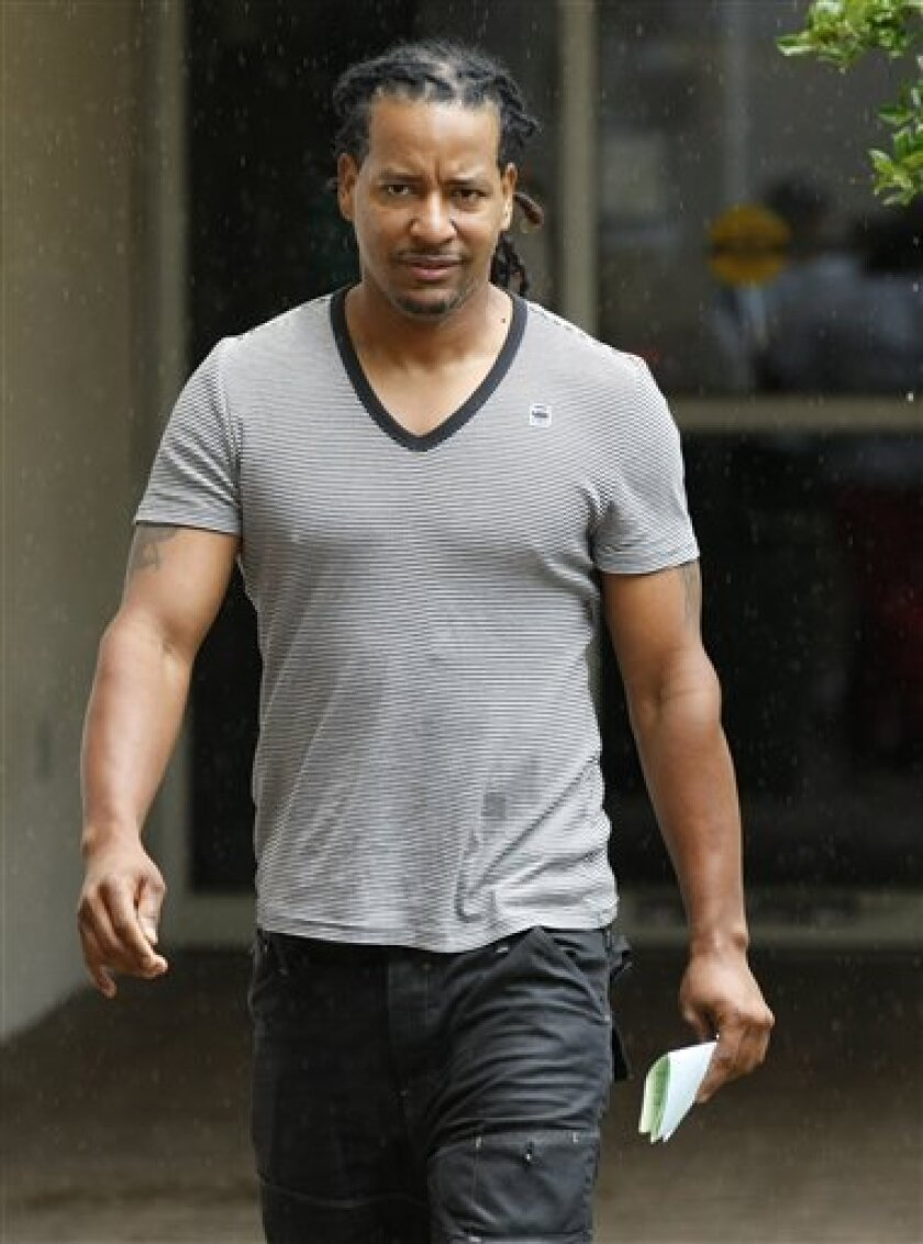 FILE - In this Sept. 13, 2011, file photo, former World Series MVP Manny Ramirez leaves the Broward County Jail in Ft. Lauderdale, Fla., after authorities arrested him for allegedly slapping his wife during a dispute at their South Florida home. Florida prosecutors have formally charged former World Series MVP Ramirez with domestic violence on Thursday, Sept. 29, 2011. (AP Photo/Hans Deryk, File)