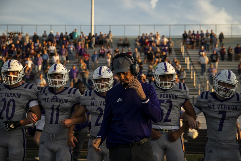 Mount Vernon High School Tigers head coach Art Briles and the Mount Vernon Tigers on the sidelines before the start of a game at Bonham High School on Friday in Bonham, Tex.