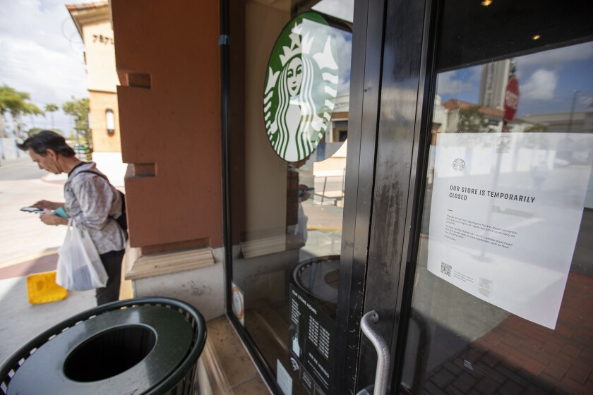 The Starbucks at Bella Terra mall in Huntington Beach was closed Monday, a day before Orange County officially ordered that all public and private gatherings outside a household be canceled and restaurant dine-in service be stopped as a precaution against the coronavirus.