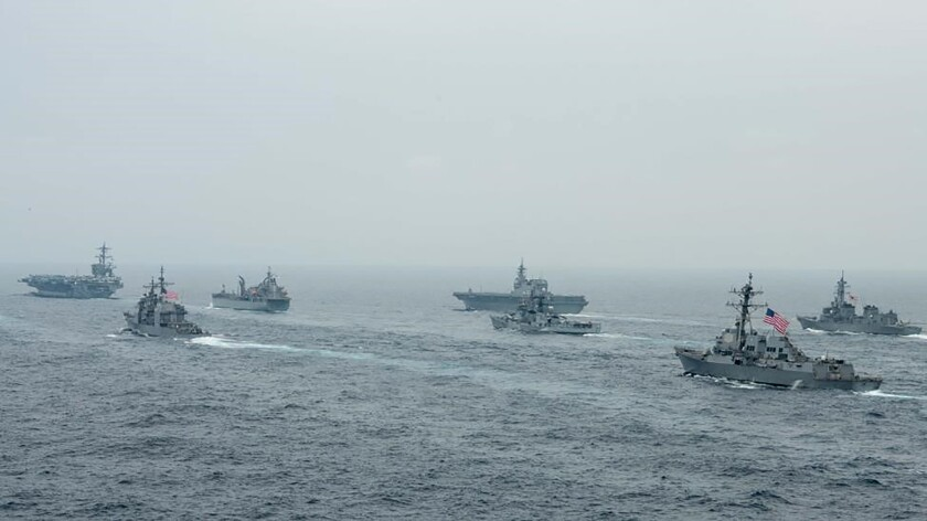 In this photo released by U.S. Navy, US Navy aircraft carrier USS Carl Vinson (CVN 70) and other US and Allies vessels transit the Bay of Bengal as part of MALABAR 2021, on Oct. 12, 2021. China seeks to bring the strategically and symbolically important island back under its control, and the U.S. sees Taiwan in the context of broader challenges from China. (Russel Lindsey/US Navy via AP)