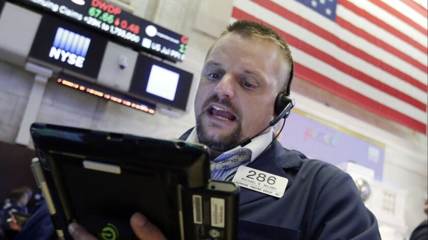 Trader Michael Milano works on the floor of the New York Stock Exchange.