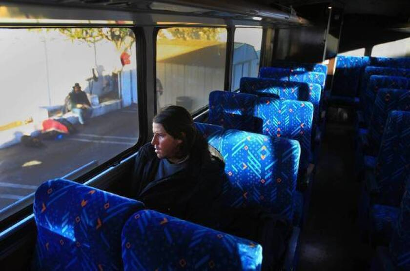 Trevor Martinez rides a free bus to the Santa Ana armory, where overnight stays are offered during cold weather.