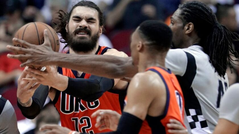 Oklahoma City Thunder's Steven Adams (12) battes for a rebound with Houston Rockets' Nene (42) as Ru