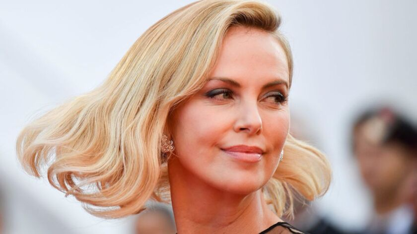 """Charlize Theron will be the focus of this year's Entertainment Weekly """"Women Who Kick Ass"""" panel."""