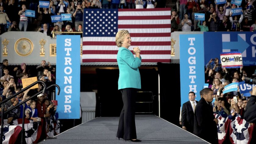Democratic presidential nominee Hillary Clinton appears at a rally in Cleveland, one of several campaign stops she made Sunday.