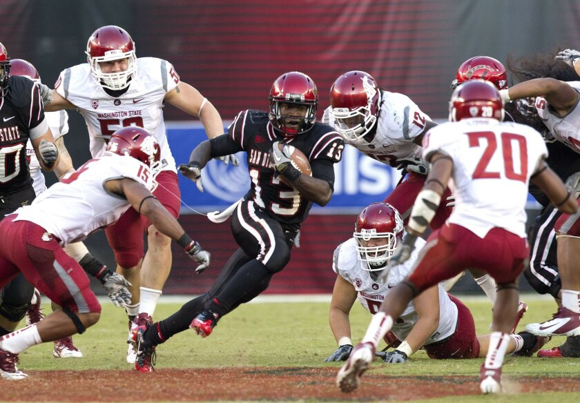 Ronnie Hillman finds a hole during SDSU's game against Washington State Saturday at Qualcomm Stadium.