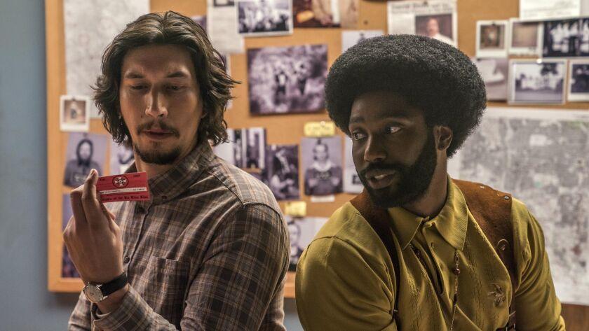 "(L-R) - John David Washington and Adam Driver in ""BlacKkKlansman."" Credit: Festival De Cannes"