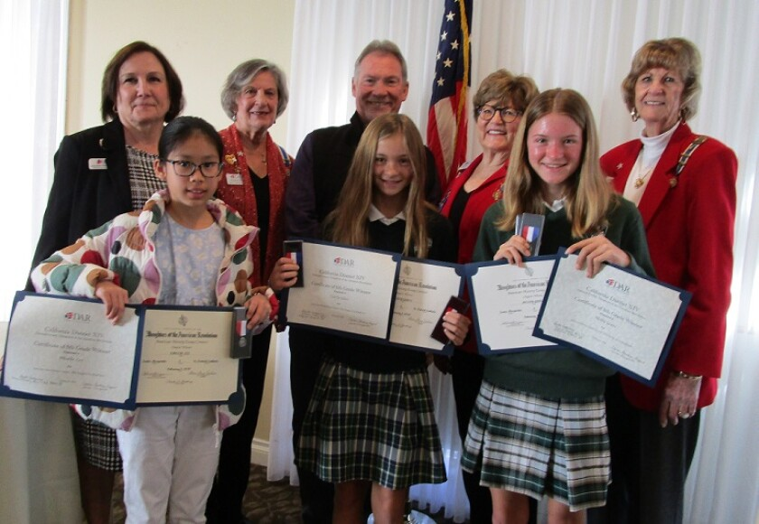 Santa Margarita Chapter DAR members and essay winners: back row, Laquetta Montgomery, Mary Catherine Kirby, Jim Burke, Charla Boodry and Alida Woodward. Front, Phoebe Lee, Carly Glass and Molly Glass.