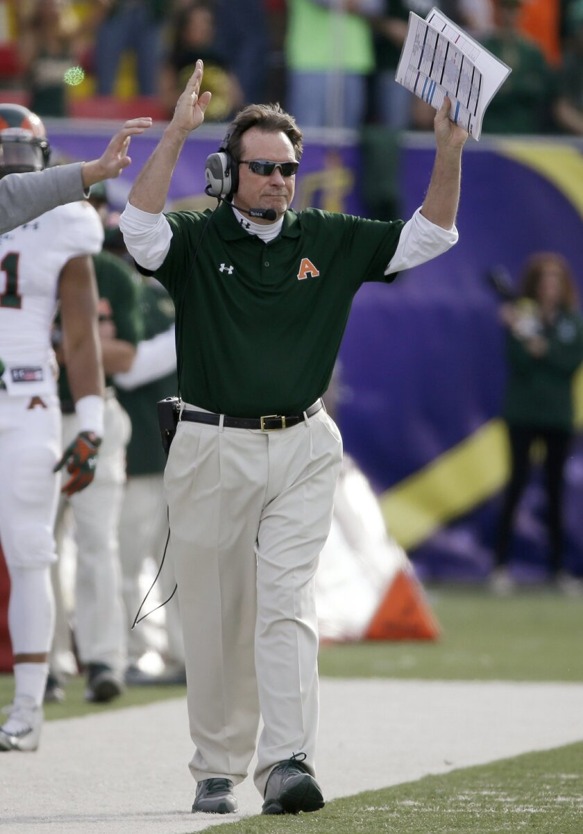 FILE - In this Dec. 20, 2014, file photo, Colorado State interim coach Dave Baldwin celebrates after his team scored a field goal against Utah during the Las Vegas Bowl NCAA college football game in Las Vegas. Now offensive coordinator at Oregon State, Baldwin has been charged with taking Oregon State's offense out of Mike Riley's era and remaking it for new head coach Gary Andersen. That means taking the Beavers from a pro-style to a speedy spread. And that's where the no-huddle comes in. (AP Photo/John Locher, File)