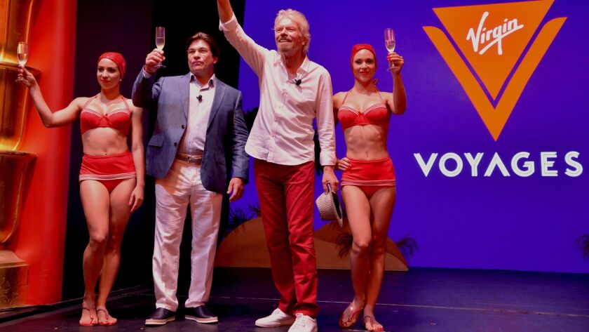 Richard Branson, second from right, and Virgin Voyages President and CEO Tom McAlpin announce the cruise line in 2015.
