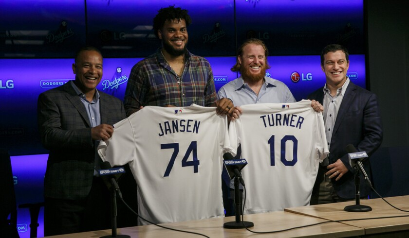 From left, Dodgers Manager Dave Roberts, pitcher Kenley Jansen, third baseman Justin Turner and President of Baseball Operations Andrew Friedman at news conference Wednesday reintroducing the two players.