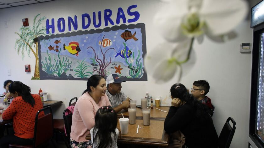 In this Thursday, June 27, 2019 photo diners eat in a Honduran-style restaurant in Chelsea, Mass. A