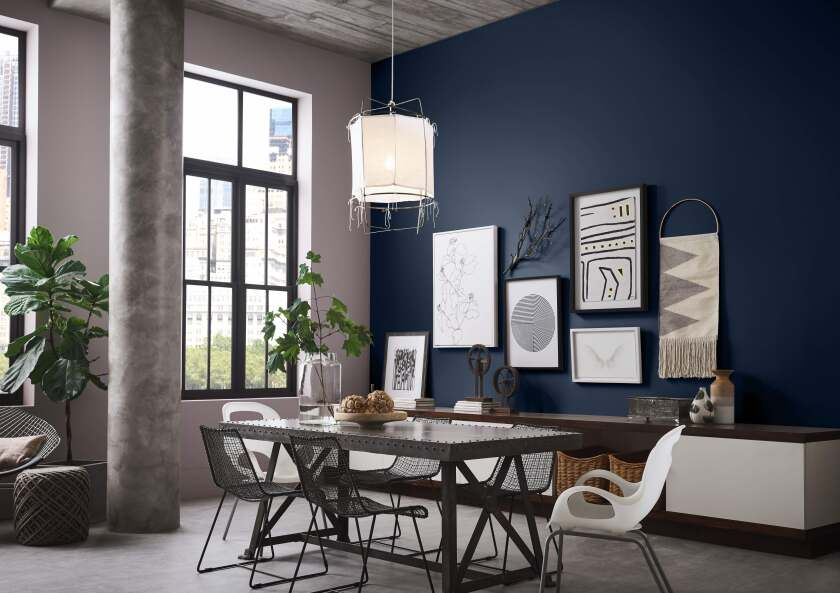 Naval by Sherwin-Williams provides a calm, cool backdrop for a gallery wall.