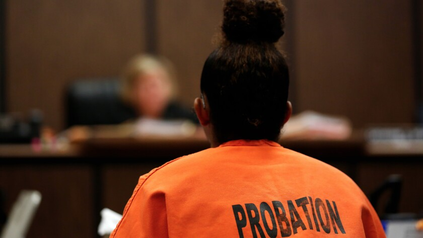 A juvenile respondent appears before Judge Catherine Pratt on a human trafficking case at the Compton Courthouse.