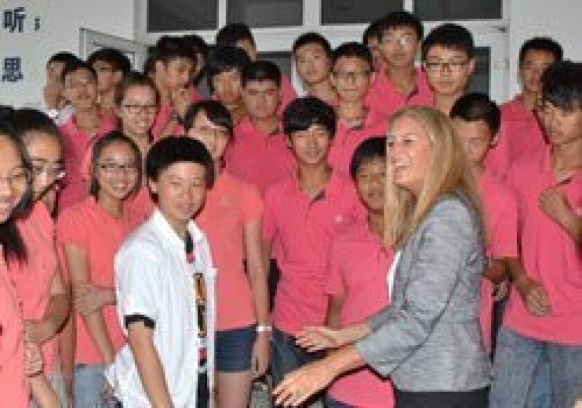 HBA's principal Jill Duoto at her recent China visit with America-bound students from FAi Qing High School in Jinhua, China.