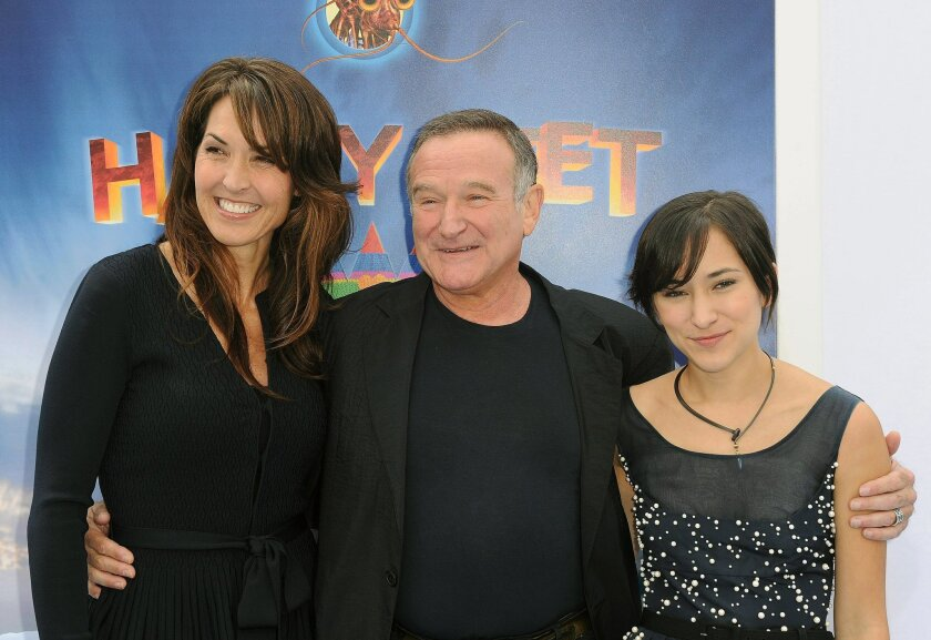 """FILE - In this Nov. 13, 2011 file photo, Susan Schneider, from left, Robin Williams, and Zelda Williams arrive at the premiere of  """"Happy Feet Two"""" at Grauman's Chinese Theater, in Los Angeles. Williams' children and wife are fighting over the late comedian's estate in a California court. In papers"""