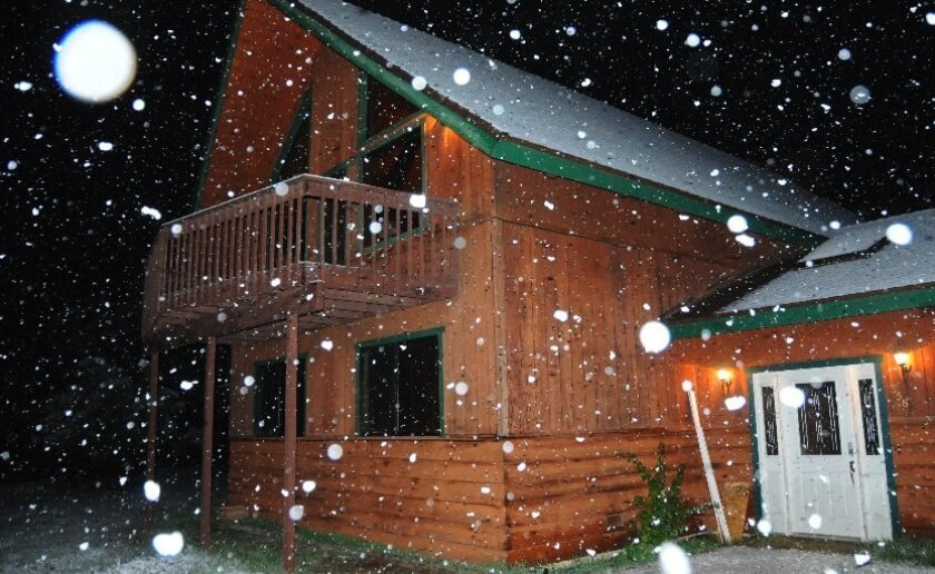 Snow falling at the 1,550-foot level in Ramona.