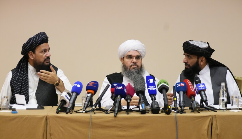 From left, Mohammad Naim, Mawlawi Shahabuddin Dilawar and Suhil Shaheen, members of a political delegation from the Afghan Taliban's movement, attend a news conference in Moscow, Russia, Friday, July 9, 2021. (AP Photo/Alexander Zemlianichenko)