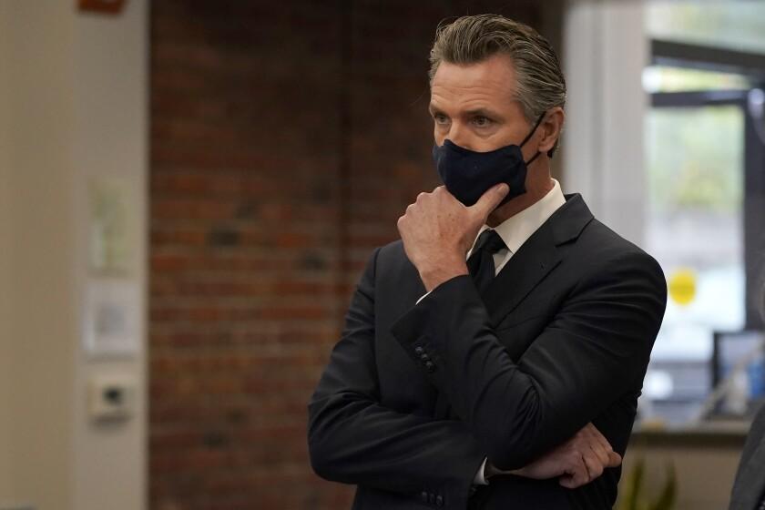 Governor Gavin Newsom wearing a black mask