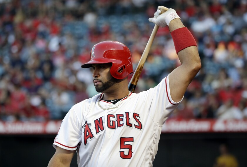 Angels' Albert Pujols prepares to bat against the Oakland Athletics.